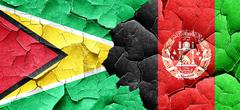 Guyana flag with afghanistan flag on a grunge cracked wall Stock Illustration