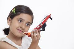 Girl playing with toy aeroplane Stock Photos