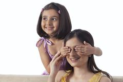 Little Girl playing Peek A Boo with her mother Stock Photos