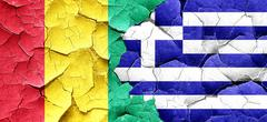 Guinea flag with Greece flag on a grunge cracked wall - stock illustration