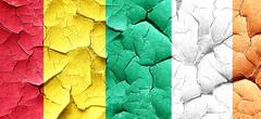 Guinea flag with Ireland flag on a grunge cracked wall - stock illustration