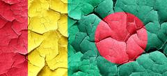 Guinea flag with Bangladesh flag on a grunge cracked wall Stock Illustration