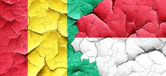 Guinea flag with Indonesia flag on a grunge cracked wall - stock illustration