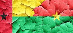 Guinea bissau flag with Burkina Faso flag on a grunge cracked wa Stock Illustration