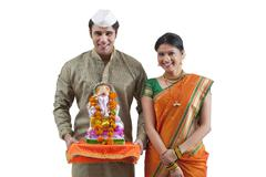 Portrait of a Maharashtrian couple with a Ganesh idol Stock Photos