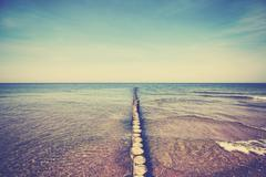 Retro old film stylized wooden breakwater Stock Photos