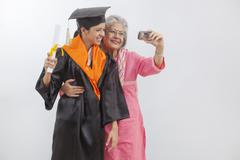Woman at granddaughter's graduation ceremony Stock Photos