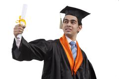 Portrait of a boy at graduation ceremony Stock Photos