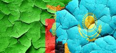 Zambia flag with Kazakhstan flag on a grunge cracked wall - stock illustration