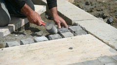 Mason working with cobblestone - stock footage