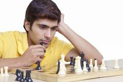Young man playing chess Stock Photos