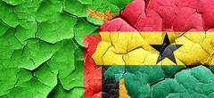 Zambia flag with Ghana flag on a grunge cracked wall Stock Illustration