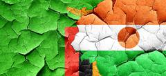 Zambia flag with Niger flag on a grunge cracked wall - stock illustration