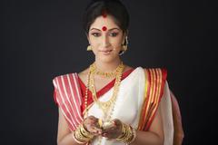 Bengali woman holding a diya Stock Photos