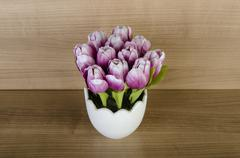 Tulip flowers against wooden background - stock photo