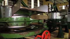 Woman works with the old tea cutting machine in Nuwara Eliya, Sri Lanka. Stock Footage