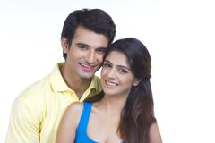 Portrait of young couple smiling together over white background Stock Photos
