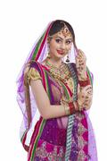 Elegant Indian bride looking away over white background Stock Photos