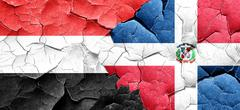 Yemen flag with Dominican Republic flag on a grunge cracked wall Stock Illustration