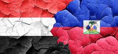 Yemen flag with Haiti flag on a grunge cracked wall - stock illustration