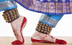 Traditional dancer's feet performing Bharatanatyam over white background Kuvituskuvat