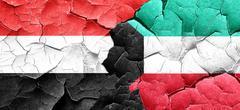 Yemen flag with Kuwait flag on a grunge cracked wall - stock illustration