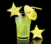 Close-up drink,carambola party on black - stock photo
