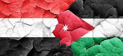 Yemen flag with Jordan flag on a grunge cracked wall - stock illustration