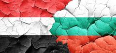 Yemen flag with Bulgaria flag on a grunge cracked wall - stock illustration