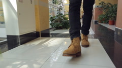 Legs of man in leather brown shoes walk inside corridor Stock Footage