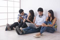 Full length of friends spending leisure time together in college Stock Photos