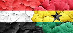 Yemen flag with Ghana flag on a grunge cracked wall Stock Illustration