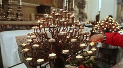 Lighting prayer candle in a church Stock Footage