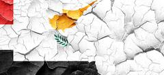 Yemen flag with Cyprus flag on a grunge cracked wall Stock Illustration