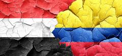 Yemen flag with Colombia flag on a grunge cracked wall - stock illustration
