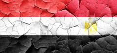 Yemen flag with egypt flag on a grunge cracked wall - stock illustration