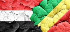 Yemen flag with congo flag on a grunge cracked wall Stock Illustration