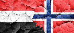 Yemen flag with Norway flag on a grunge cracked wall Stock Illustration