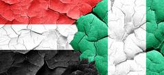 Yemen flag with Nigeria flag on a grunge cracked wall Piirros