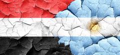 Yemen flag with Argentine flag on a grunge cracked wall Stock Illustration