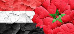 Yemen flag with Morocco flag on a grunge cracked wall Stock Illustration