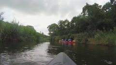 Ride a kayak in River Stock Footage