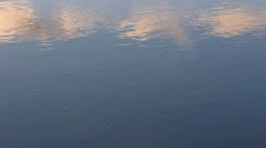 Ripples and reflection on the water - stock footage