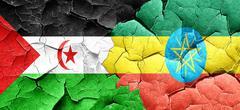 Western sahara flag with Ethiopia flag on a grunge cracked wall Piirros
