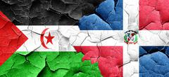 Western sahara flag with Dominican Republic flag on a grunge cra Stock Illustration