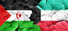 Western sahara flag with Kuwait flag on a grunge cracked wall Piirros