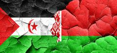 Western sahara flag with Belarus flag on a grunge cracked wall Stock Illustration