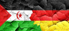 Western sahara flag with Germany flag on a grunge cracked wall Stock Illustration