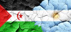 Western sahara flag with Argentine flag on a grunge cracked wall Stock Illustration