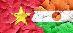 Vietnam flag with Niger flag on a grunge cracked wall Stock Illustration